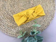Трикотажна пов'язка для дівчинки (темно-жовта), Talvi 0189